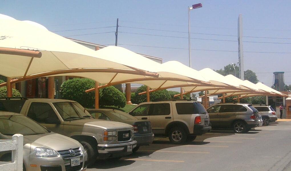 Cocheras y estacionamientos cuball tenso cubiertas for Toldos para estacionamiento